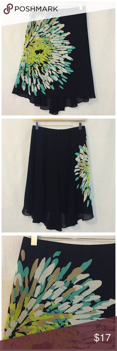 """Ann Taylor Floral Navy Blue Airy High Low Skirt 4 Ann Taylor Floral Navy Blue Airy High Low Skirt  • Sz 4 • 14.5"""" waist (measured flat) (elastic interior waistband) • 25""""-27"""" length • Shell is sheer polyester with a large flower print • Lined in opaque polyester • Good preloved condition, gently worn, no imperfections Ann Taylor Skirts"""