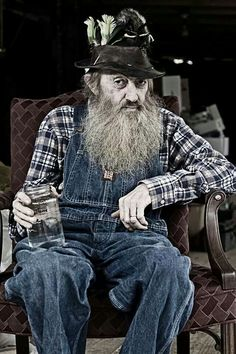 """A scrawny, long-bearded mountain man with a foul mouth & a passing acquaintance with copper tubing & kettles, Marvin """"Popcorn"""" Sutton seemed the embodiment of moonshiners of yore Brought up in rural Cocke County, Tenn, identified as one of four """"moonshine capitals of the world"""" in the corn-whiskey history """"Mountain Spirits,"""" Mr. Sutton learned the family trade from his father. Going back to the Scots-Irish, who brought it to the New World & it wasn't illegal until after the Civil War."""