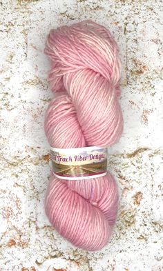 Graceful is a tonal light pink colorway. This is available on my new Daisy DK single ply base. #artisanyarn #rainbowyarn #knit #crochet #handknit #handdyed  #findyourfade #knittinglifestyle #makersgonnamake #knittingaddict  #knittersoftheworld #dreaminyarn #knitlife #yarnlife #crochetlove #mcnyarn #sparklyyarn #indieyarn #knitaholic #DKyarn