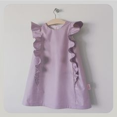 charlotte dress: handmade a-line dress in mauve polished cotton feature soft ruffles cascading over the shoulders front and back.charlotte : modern girl dress / mette on Etsy Frocks For Girls, Kids Frocks, Little Girl Dresses, Baby Girl Fashion, Kids Fashion, Fashion Outfits, Baby Girl Dress Patterns, Skirt Patterns, Coat Patterns