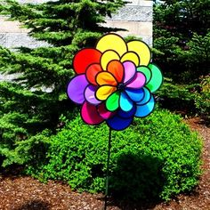 Triple Wheel 24 Petal Flower Spinner.  Triple Wheel 24 Petal Flower Spinners will mesmerize you as they spin. Wheels measure 19 inch,14 inch and 10 inch diameter with a 2 piece 35 inch fiberglass pole with metal coupler and a 7 inch ground stake.The flower petal wheels have been assembled. Each wheel is designed to spin opposite each each other giving a blur of color.  #flower #windspinner #yarddecor