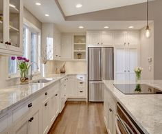 kitchen island with cooktop in Kitchen Transitional with electric cooktop bright space