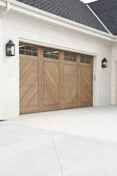 Natural wood colored herringbone garage doors.