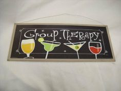 """Group Therapy Cocktails Wine Margaritas Wooden Wall Art Sign Drinking Bar Decor by The Little Store of Home Decor. $24.99. size 9x21. Made in the USA. We've sealed this Group Thereapy art print onto wood giving it a framed appearance. We've painted the background wood a creamy tan color with touches of brown and black to accent the print. It measures approximately 9"""" tall by 21"""" long by 1/4"""" thick. We've added a rusty tin wire for easy hanging."""