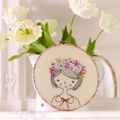 A darling flower girl project for hoop embroidery by hand. A sweet keepsake for someone you love.