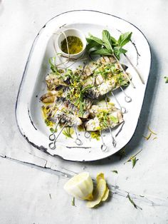 Doing a fishy BBQ? Try grilled sardines with rosemary and chilli, August 2013. Recipe from Olive Magazine.