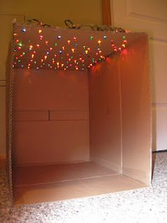"""star"" box with Christmas lights - could transform to a reading nook."