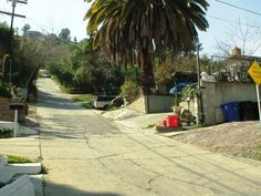 The third and fourth steepest residential streets in the world are located in Los Angeles (that's right, not San Francisco, which can't claim number one OR two, either).  This is Eldred Street, which climbs the north side of Mount Washington in Highland Park.  These two streets have their very own garbage trucks that back UP the street once a week, the post office can not deliver to the houses on top, and a good number of vehicles have come to ruin attempting to make it to the top.