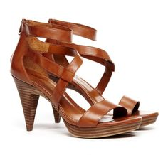 Strappy sandal with stacked leather heel and back zip closure.