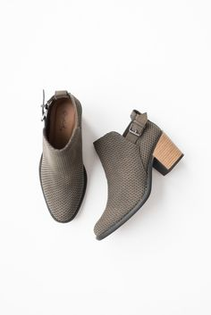 """Faux suede ankle booties with laser cut-out texture Side ankle buckle 2.5"""" cut-out back heel Lightly padded insole Rubber sole All man made material True to US"""