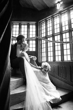 Bride and groom sit on the stairs at the magnificent Leeds Castle © Fiona Kelly Photography