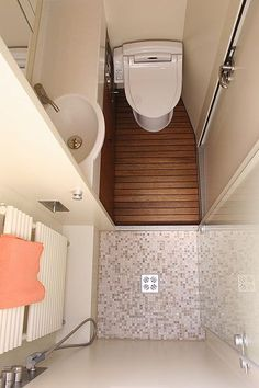 Tiny homes have to make efficient use of space and that includes the bathrooms. A tiny house bathroom has to accommodate a toilet, a bath and/or shower, and a sink in a very small amount of space.