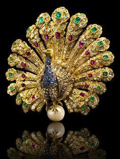 A gem-set and diamond Peacock Bbrooch, by Gustave Baugrand, ca 1865, via Bonhams auctions.
