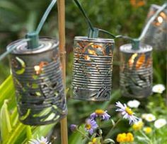 Number: 35  Skill level (out of 10): 2  Other items needed : Christmas Lights, Tin cans   Idea Type: Upcycled Tin Can Lights   Design: Garden Lighting