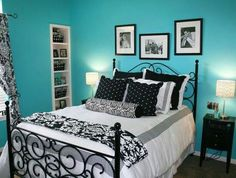 Black and white bedding with turquoise throw blanket and pillows.
