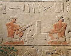 Egyptian, Ancient Memphis, relief at the Mastaba of Akheteps Saqqara, Old Kingdom, 5th dynasty. Relief depicting two scribes.