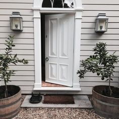 Perfect symmetry: the Georgian style modern entry of Cameron Kimber's Australian country house is painted Dulux Cashmere with the front door In Dulux Whisper White; garden tubs and gravel from local hardware supplier,. House Exterior, Weatherboard House, House Paint Exterior, Front Door, House Painting, English Design, Australian Country Houses, House, Exterior House Colors