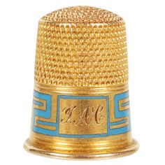 FABERGE Gold and Enamel Thimble  Russia  1900  A Faberge gold and champleve enamel thimble, St. Petersburg, circa 1900. Of traditional form with a turquoise enamel Greek-key design band.