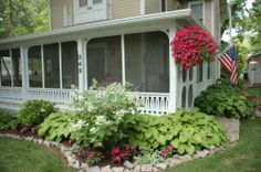 Screened in front porch - Lakeside flower garden.