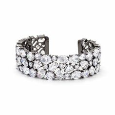 Bejeweled CZ Cuff Black Tone  Hematite Bonded Cuff with Prong Set Round Cut Oval Cut and Pear Cut Clear Cubic Zirconia in Black Tone  Bold hues and encrusted-filled jewels play up our statement cuff. Throw it on with a t-shirt and jeans for instant everyday glamour.