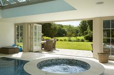 Explore Westbury Garden Rooms' case studies: glass garden rooms through to wooden orangeries, conservatories, pool houses and kitchen extension projects. Victorian House Interiors, Victorian Homes, Westbury Gardens, Swiming Pool, Glass Room, Indoor Swimming, Glass Garden, Pool Houses, Spa