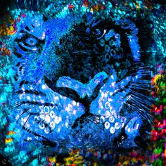Rajah print in blue  This tiger is watching you. The beautiful jewels that surround him soften his arresting stare. A kaleidoscopic border shifts the focus from his stare and gives a balance between intensity and gentle beauty.