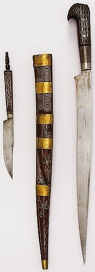 Algerian (Kabyle) knife, 19th century, steel, wood, silver wire, brass, H. with sheath 18 1/4 in. (46.4 cm); H. without sheath 17 5/16 in. (44 cm); H. of blade 13 in. (33 cm); Wt. 11.9 oz. (337.4 g); Wt. of sheath 2.8 oz. (79.4 g, Met Museum, Bequest of George C. Stone, 1935.