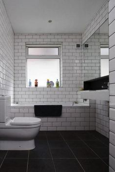White subway tile with grey grout - simple but effective. Guess you could use any colour grout really