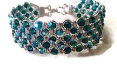"Give a gift that lasts. Sherry's Jewelry, the place to shop..  This bracelet is 7""L x 1"" W  It was Handmade with sterling silver wire (925) and 94 emerald green aurora borealis Swarovski crystals  Finished with an easy on/off hook and ... #handmadehour #jewelrylovers #style #fashion"