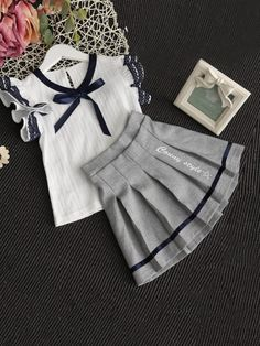 Shop Girls Contrast Lace Ribbon Detail Top With Skirt online. SheIn offers Girls Contrast Lace Ribbon Detail Top With Skirt & more to fit your fashionable needs. Kids Frocks, Frocks For Girls, Dresses Kids Girl, Little Girl Outfits, Kids Outfits, Baby Girl Fashion, Fashion Kids, Latest Fashion, Baby Dress Design