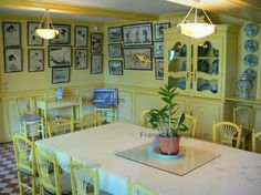Claude Monet's house and gardens : Inside Monet's house, in Giverny: yellow dining room and its collection of Japanese prints