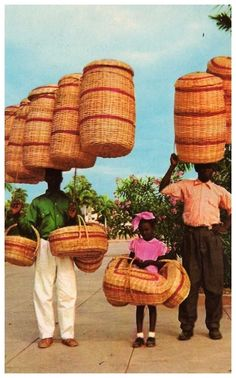 Haiti~~man on left has 5 (count em!!) baskets on his head...how does he do it??