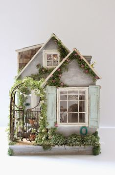 Lovely summer house! http://www.cinderellamoments.com/2015/04/summer-house-custom-dollhouse.html?utm_source=feedburner