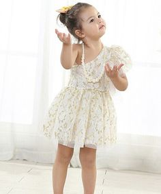 Look at this #zulilyfind! White Lace Asymmetrical Dress - Toddler & Girls by Designs by Meghna #zulilyfinds