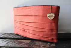 How can I pick just one? — Control Clutch Pinkish Coral Linen Clutch by YellowWallpaper, $45.00