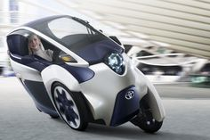 The Toyota i-Road personal mobility concept looks all prepared to roll out at the Geneva International Motor Show. As you can see in the image above, the Toyota i-Road would come across as an ultra-compact, tandem two-seater electric vehicle [. Reverse Trike, Concept Cars, Moto Journal, Maxi Scooter, Lambretta, Automobile, Third Wheel, Geneva Motor Show, Toyota Cars