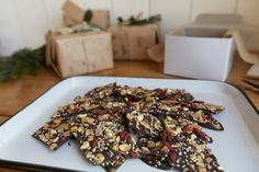 DIY Healthy Dark Chocolate Bark with berries, seeds and nuts! Perfect gift for the holidays. Includes a DIY festive gift wrap!