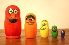Sesame Street Nesting Dolls  Friendly Sesame Street characters and vibrant rainbow colors are painted on these wooden stacking dolls