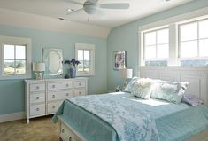 Family Home with Small Interiors and Open Floor PlanThe soothing, coastal paint color in the master bedroom is Waterscape by Sherwin Williams. Isn't it a great color?