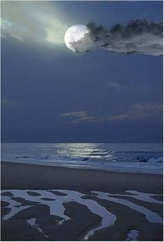 full moon rising on the beach