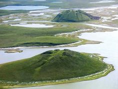 Dome-shaped hill formed in a permafrost area when the hydrostatic pressure of freezing groundwater causes the upheaval of a layer of frozen ground. Pingos may be up to 90 metres (300 feet) high and over...