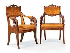A PAIR OR RUSSIAN MAHOGANY ARMCHAIRS  CIRCA 1820-40  Elaborately-carved overall, the pierced shaped back with foliate cresting centred by a shell, with acanthus-wrapped downswept arms and seat covered à châssis in caramel leather.