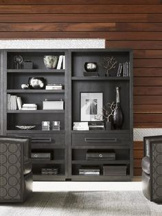 A bookcase like this one might be one of the most versatile and functional pieces in your home. A bookshelf can do double duty as a showcase for books, decorative accessories, and photographs as well as a storage spot for movies or a stereo system.