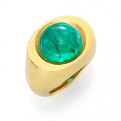 A cabochon emerald and gold ring, by David Webb