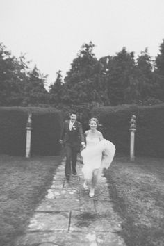 Yay! We're married! Newlyweds running through the grounds of their castle venue.