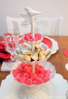 DIY Valentine's Day tablescape with heart-shaped doilies. I repurposed a jewelry holder to candy. DagmarBleasdale.com