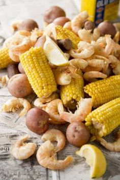 Paula Deen's Low Country Boil: 6 ears of corn, cut in half, 6 4-in smoked link sausages, 12 red new potatoes, cut in half, 3 lb fresh shrimp, unpeeled, crab boil, 2 tsp per quart of water...Fill large pot with enough water to cover all ingredients. Add crab boil to taste  bring to boil. When water boils, add potatoes  sausage. Cook on med heat for 20 min. Add corn  cook 10 more min. Add shrimp  cook for no more than 3 min. Drain  serve with warm bread. (can also add crab and/or scallops)