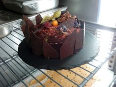 Gianduja chocolate cake with russberrys and chocolate biscui