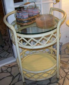 Found on EstateSales.NET: Rolling tea cart with glass top