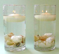Copos de vidro viram castiçais decorados com conchas